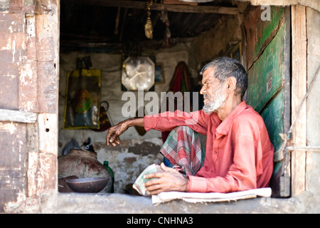 Old  Muslim man in his hut on the way to Taraghat , Ajmer india - Stock Photo