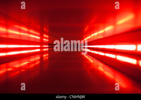 An abstract corridor in red tones - Stock Photo