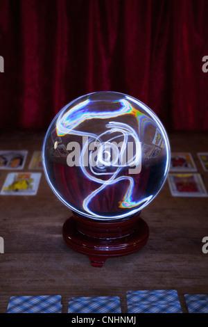 A crystal ball and tarot cards - Stock Photo