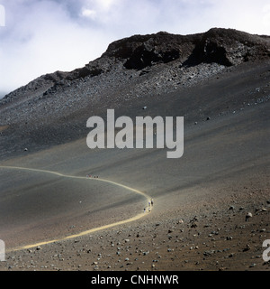 Hikers on a trail in the Haleakala National Park - Stock Photo