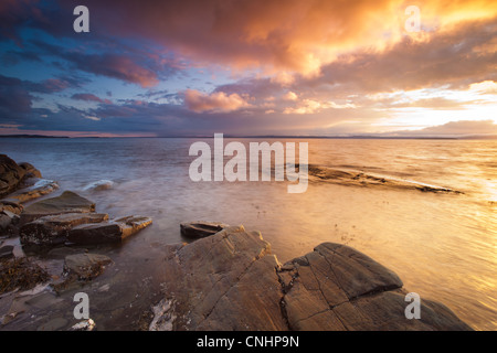 Beautiful sunset by the Oslofjord at Nes on the island Jeløy, Oslofjorden, Norway. - Stock Photo