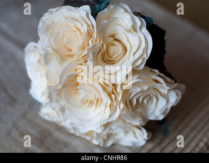 brides bouquet of white cream roses on wedding morning - Stock Photo