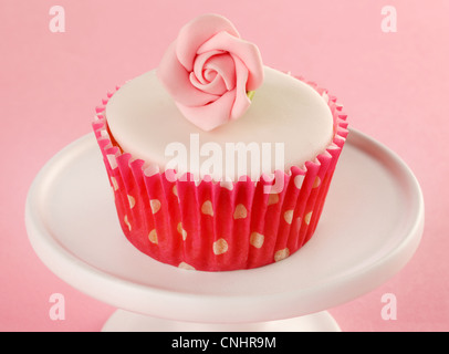 PINK ROSE CUPCAKE - Stock Photo