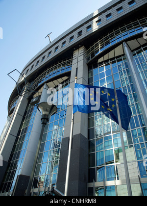 European Parliament building with EU flag, Brussels, Belgium - Stock Photo