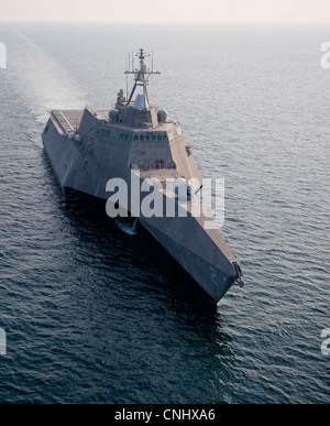 The new USS Independence, a littoral combat ship, steams through the Atlantic Ocean April 9, 2012 off the coast - Stock Photo