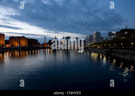 Sunset over waterfront out to Albert Dock and city skyline, Liverpool, UK - Stock Photo