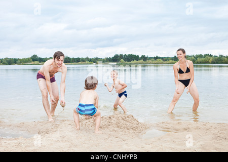 Family playing on a beach - Stock Photo