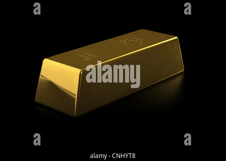 Fine gold bar on black background - Stock Photo