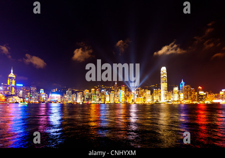 Skyline of Victoria Harbour at night, Hong Kong - Stock Photo