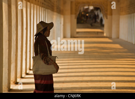 Burmese woman in the corridor at Shwezigon Pagoda, Bagan. Burma. Model Released. - Stock Photo