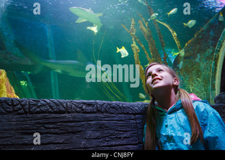 Girl looking at the fish from the 'Ocean Tunnel' at Sea Life aquarium, Blackpool. - Stock Photo