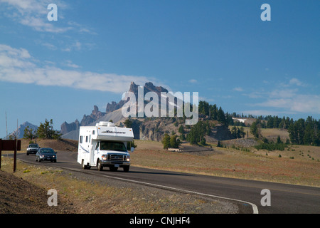 Vehicles travel through Crater Lake National Park located in southern Oregon, USA. - Stock Photo