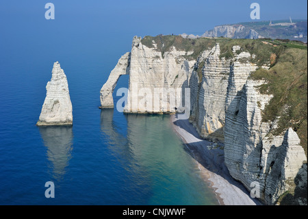 L'Aiguille and the Porte D'Aval, a natural arch in the eroded chalk cliffs at Etretat, Côte d'Albâtre, Upper Normandy, - Stock Photo