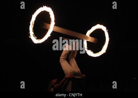 Fire juggler Lidvik Navratil performs in Humberto Circus in Prague, Czech Republic. - Stock Photo