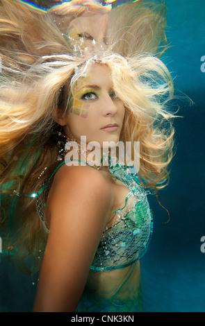 Blond mermaid in pool, Virginia Beach, Virginia. - Stock Photo