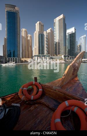 The skyscrapers of the 'Dubai Marina' area, seen from a traditional dhow (Dubai - the United Arab Emirates). - Stock Photo