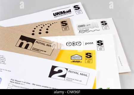 letters delivered by various postal delivery companies - Stock Photo