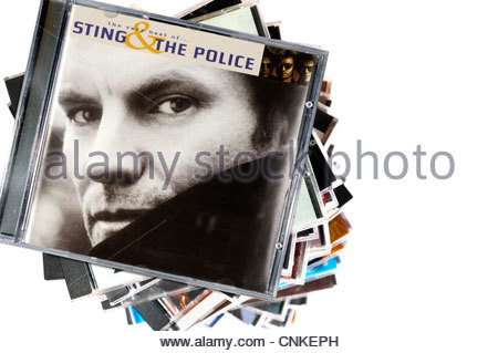 Sting & The Police album the very best of, piled music CD cases, England. - Stock Photo