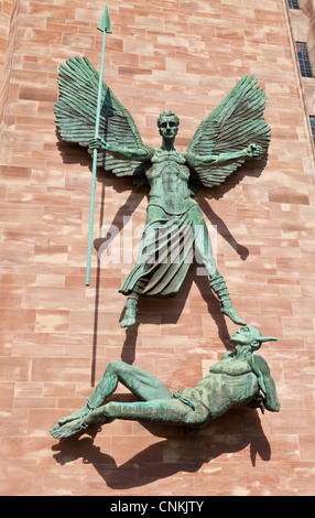 Sculpture of St Michael and the Devil on the wall of Coventry cathedral west midlands England UK GB EU England - Stock Photo