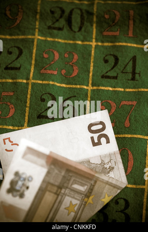 a 50 EUR note on a roulette table - Stock Photo