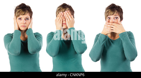 Young woman posing like the three monkeys - no hear no see and no speak. Isolated studio shot against a white background. - Stock Photo