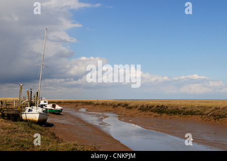 Boats in Thornham Harbour, Norfolk, England, UK - Stock Photo