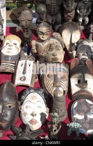 African masks at the Geneva, Switzerland flea market. - Stock Photo