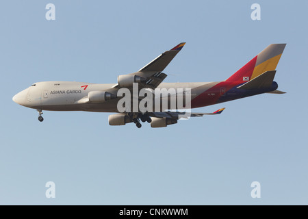 Asiana Cargo Boeing 747-400 freightliner on final approach - Stock Photo