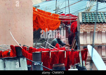 Traditional Wool dye process in the Souks of Marrakesh, Morocco - Stock Photo