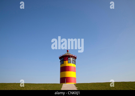 Pilsumer Leuchtturm lighthouse near Greetsiel, East Frisia, Lower Saxony, Germany, Europe - Stock Photo