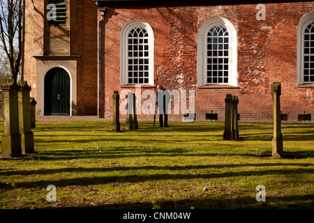 church Friedenskirche and cemetery in Leer , East Frisia, Lower Saxony, Germany - Stock Photo