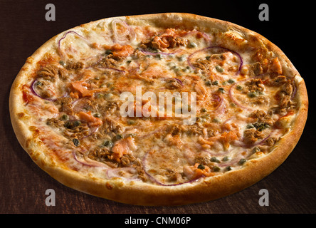 Pizza pesce with tuna fish, salmon, onion and capers - isolated - Stock Photo