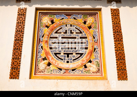 Symbol of longevity on a wall of the Hall of the Mandarins in the Imperial City, Hue, Vietnam - Stock Photo