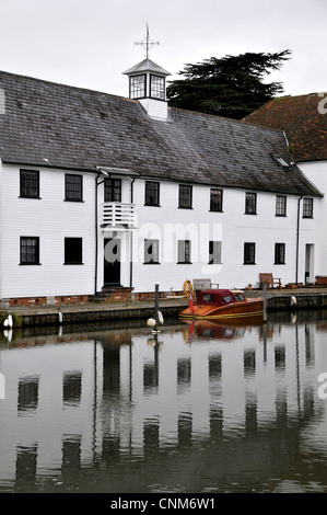 Graphic photo of a row of terraced white cottages on the weir at Hambleden with strong reflections in the River - Stock Photo