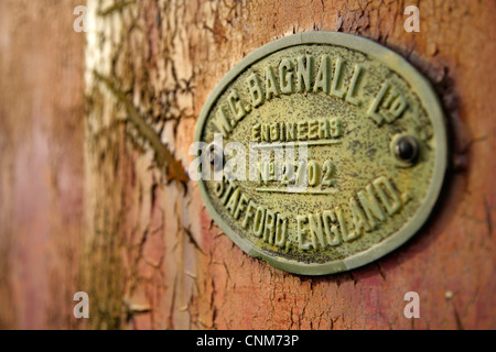 Maker's plate on old railway wagon. - Stock Photo