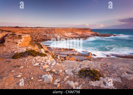 Late afternoon light on rugged cliffs at Coodlie Park near Venus Bay on the west coast of the Eyre Peninsula in - Stock Photo