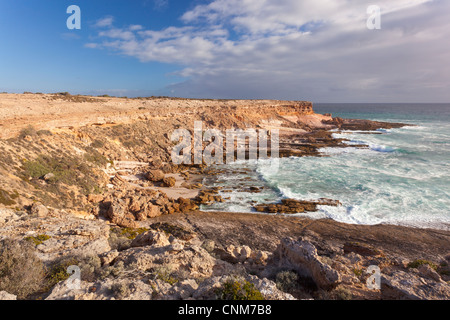 Late afternoon light on the rugged and dramatic cliffs of Coodlie Bay near Venus Bay on the West Coast of the Eyre - Stock Photo