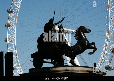 Statue of Boadicea on Victoria Embankment framed by the London Eye, Westminster, London, UK - Stock Photo