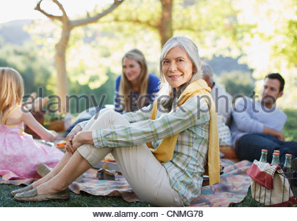 Family picnicking together outdoors - Stock Photo