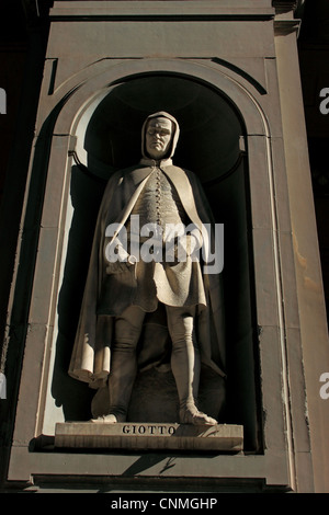 A statue of Giotto decorates the facade of the Uffizi gallery, Florence, Italy, February 27, 2012. - Stock Photo