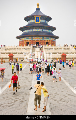 Tourists visiting and taking photographs at the The Hall of Prayer for Good Harvests within the Temple of Heaven - Stock Photo