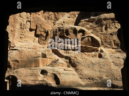 Cliff formations of the Siq al-Barid showing remains of the Nabatean culture seen from a cave in Little Petra. Beidha, - Stock Photo