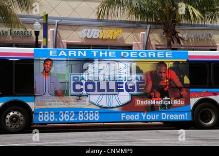 Miami Beach Florida Washington Avenue Miami-Dade Metrobus public bus advertising earn college degree - Stock Photo