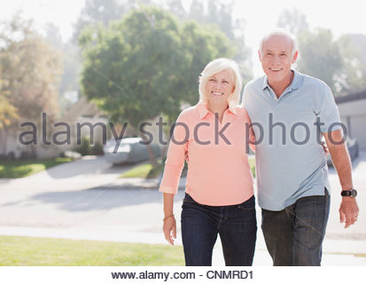 Smiling older couple walking together - Stock Photo