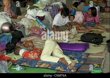 Refugees recent volcanic eruption resting temperary accommodation stadium Maguwo Mount Merapi Central Java Indonesia - Stock Photo