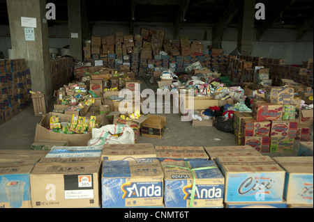 Boxes of supplies for refugees from recent volcanic eruption, Maguwo, Mount Merapi, Central Java, Indonesia, november - Stock Photo