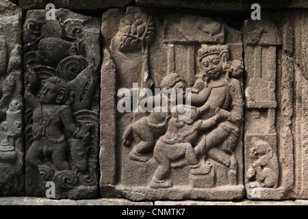 Relief from Prambanan Temple near Yogyakarta, Central Java, Indonesia. - Stock Photo