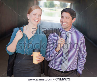 Business people walking together in tunnel - Stock Photo