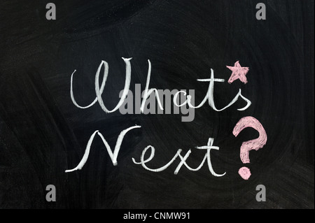 Chalk writing - What's next words written on chalkboard - Stock Photo