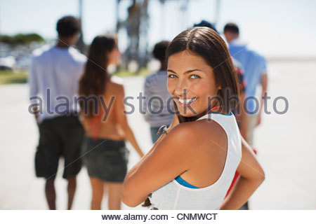 Smiling woman walking outdoors - Stock Photo